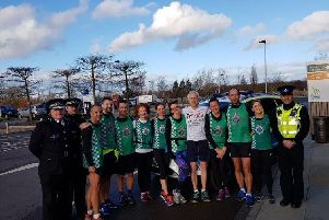Paul Lander having completed his 100th and final triathlon at the National Memorial Arboretum with Staffordshire Police Chief Constable and the force running team who accompanied him on the last leg