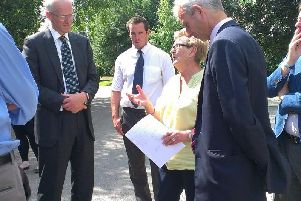 HS2 boss Sir David Higgins speaks to Stoke Mandeville Parish Council chairman Jenny Hunt, in the yellow, during a visit to Old Risborough Road, which will be one of the places affected by the high speed rail line