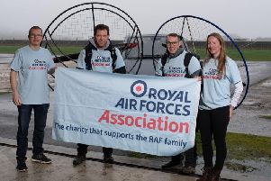 (Centre, l-r) Paramotorists Paul Mockford and Flight Lieutenant Giles Fowler with their air crew Andy Greves and Katie Pagett.