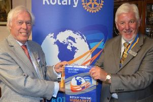 From the archives: Rotary District for Bucks, Beds & Herts Governor Chalmers Cursley presents Rotary Club of Aylesbury Hundreds President Roger King with a 'Rotary Serving Humanity' banner