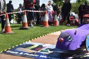 Competitors taking on the soapbox derby runway at Whitehill Park, Aylesbury