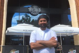 Usman Majid outside The Grill Steakhouse in Aylesbury town centre