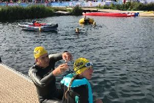 Shelley Halsey prepares to enter the water at the start of her Superhero Triathlon