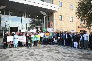 Protesters gathered outside the AVDC building this morning