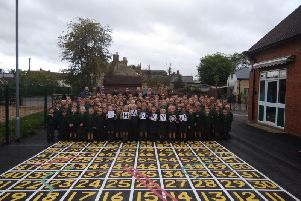 Pupils in the playground with their newly refurbished surface
