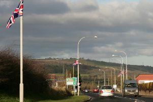 (file pic) Flags on the approach to Whitehead.