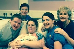 Kyron Gatley - born at 12.03am New Year's Day - with parents Catherine and Nathan and Altnagelvin Hospital staff