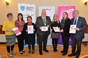 David Gillespie (right) and Hazel Bell (left), representing Ledcom  with representitives from Mid and East Antrim Borough Council (from left)  Councillor Ruth Wilson, Councillor Gerardine Mulvenna, Mayor, Councillor Paul Reid, Gail Kelly and Zoe Lindsay at the official launch of the 2018 Larne Business Awards in Larne Town Hall. INLT 06-006-PSB