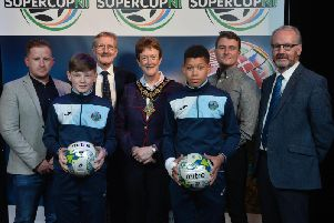 SuperCup NI Chairman, Victor Leonard, Joan Baird OBE, Mayor of Causeway Coast and Glens Borough Council and councillor Billy Henry, Mid and East Antrim Borough Council, pictured with Greenisland U13 manager Niall McGovern, coach Marc Gamble and players Jack Patterson and Reece Black.