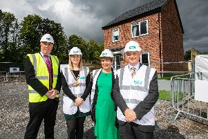 Eugene Lynch, Managing Director of The McAvoy Group, Cllr Cheryl Johnston, Deputy Mayor for Mid and East Antirm, Clare McCarty, Group Chief Executive at Clanmil Housing and David Orr, Chief Executive of the National Housing Federation in front of a prototype house at Clanmil's site in Carrickfergus, where 40 new social homes will be the first in Northern Ireland delivered using off-site construction.