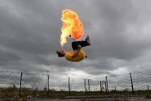 Ryan Luney, a three time Guinness World Record holder pictured in Belfast doing backflips while firebreathing. 'Pic Colm Lenaghan/Pacemaker