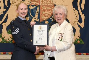 Cadet Sergeant Catherine Hill from Ballynure is pictured receiving the certificate which marks her honour from Mrs Joan Christie, Her Majesty's Lord Lieutenant for the County of Antrim.