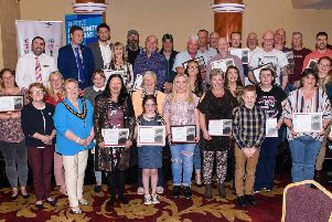 The Local Area Networks proudly pose with their certificates at the 'For Your Freedom and Ours' celebration event.