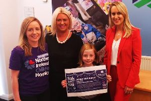 Solving Kids Cancer research co-ordinator and Oscar Knox's mum, Leona Knox with daughter Izzie, Northern Ireland Children's Hospice's Noreen Kennedy and Mallusk Enterprise Park CEO Emma Garrett announcing the event to support NI Children's Hospice.