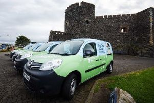 Green Dog Walker vans at Carrickfergus Castle.