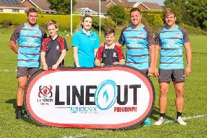 Carrickfergus Grammar School pupils Noel McCaffrey and Saul Logan  with Ulster Rugby professionals Sean Reidy, Rob Herring and Jordi Murphy and Ciara Watson, Phoenix Natural Gas.