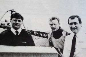 Coastguard Bill Bennett with members of the Larne Coastguard who took part in a rescue off The Maidens - Martin Agnew and Drew Girvan with auxiliary Jim Bearns. 1992