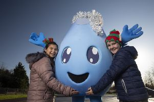 NI Water's winter mascot 'Flo' is on the road again this year to help remind the public to prepare for freezing temperatures and ensure that the water continues to 'Flo' freely through our pipes all winter long.   ''Pictured helping Flo deliver winter advice is Sarah Jane Armour and Chloe Patterson