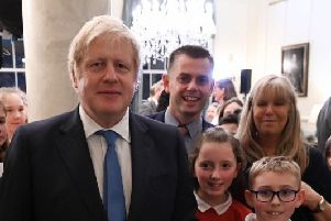 Ballysally Primary School pupils Keeley Riley and Daniel Drawmer, along with school principal Geoff Dunn and P6 teacher Mrs Deirdre McKeown, meeting Prime Minister Boris Johnson at Downing Street.