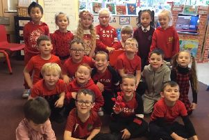 Pupils dressed in red to raise funds and awareness for the Children's Heartbeat Trust.