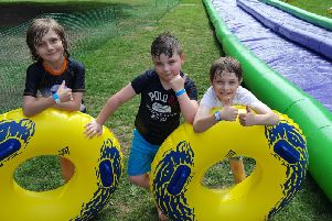 William, Archie and Noah after sliding down the Slip and Slide mat