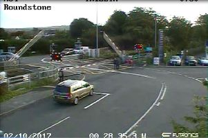 CCTV footage of the cyclist, seen in pink, just before getting caught on the tracks at the Roundstone level crossing in East Preston. Picture: Network Rail