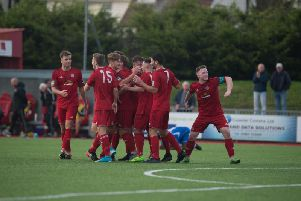 Worthing celebrate a goal during their first-round qualifying win over Lowestoft Town on Saturday. Picture by Marcus Hoare
