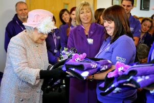 The Queen visited Canine Partners, Mill Lane, Heyshott, recieves gifts. Pic Steve Robards SR1728947 SUS-171130-151021001