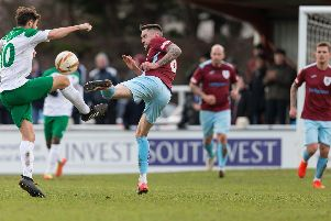 Harvey Whyte challenges for the ball in the Rocks' FA Trophy win at Taunton on Saturday / Picture by Tim Norbury