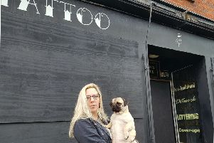 Leah Elphick, owner of the Black Pearl Tattoo Parlour, has decided to leave the shop boarded up after its windows were smashed.