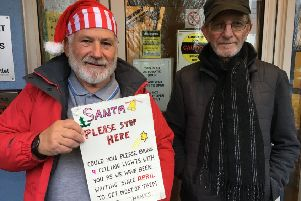 Residents Ray Stenning (dressed as Santa with one of the signs) and John Hostler