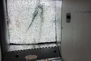 The smashed windscreen of the train after it hit a large tree on the line.