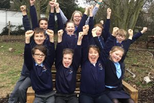 Eco TA, Karen Buncle, and pupils celebrate Southbournes Eco Schools silver award and good Ofsted rating
