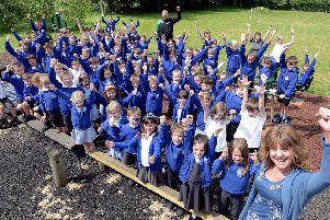 Headteacher Sarah Titley, staff and pupils celebrate their Ofsted report