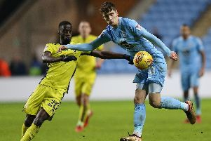 Pompey target Mo Eisa, left, in action against Coventry