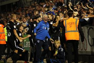 Pompey celebrate their success at Bristol Rovers. Picture: Joe Pepler