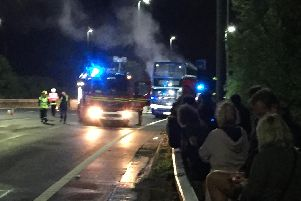 A bus full of festivalgoers burst into flames on the M275 last night. Picture: Mark Waldron