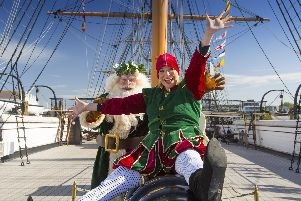 Father Christmas and Miss Chief having fun on board HMS Warrior 1860 at Portsmouth Historic Dockyard's Festival of Christmas.  Picture: Chris Stephens.
