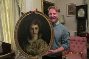 Nick Cobden-Wright with a portrait of his great grandmother he discovered at Dunford House. SUS-181112-131924001