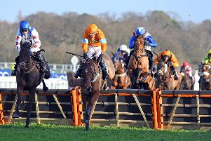 Over they go at sunny Ascot / Picture: Malcolm Wells
