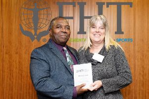 Alison Brown receives her 2018 FHT Local Support Group Co-ordinator or the Year award from vice president Herman Fenton for sharing the content of her group meetings via a number of online platforms for therapists unable to attend in person