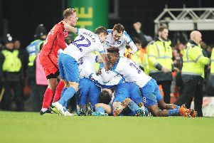 Pompey celebrate their late winner. Picture: Joe Pepler