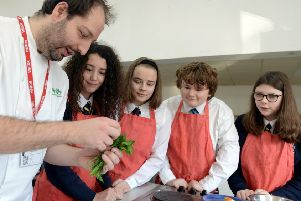 ks190029-2 Orminston Cook Competition  phot kate'Nathaniel Molineaux demonstrates how to use herbs to pupils Amelia Cox, 13, Ellenor Wilson, 13,  Nathaniel Molineaux, and Emma Howson, 14..ks190029-2 SUS-190122-204525008