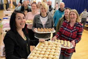 ks190051-1 Selsey Cake  Sale'Sarah Gibson, front left and some of the team who 'made her cake sale such a success.ks190051-1 SUS-190202-183456008