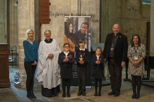 The reverends, charity manager and pupils from South Bersted C of E School