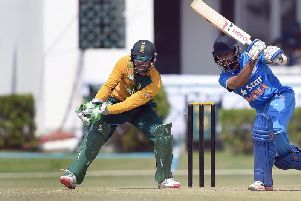 South African wicketkeeper AB de Villiers watches as India A cricketer Manan Vohra plays a shot (Photo PRAKASH SINGH/AFP/Getty Images)