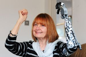 Annastasia Feltham from Clymping is delighted with her 3D printed arm. Picture: Kate Shemilt