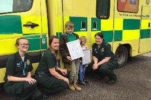 Sean-Michael Corcoran and his sister Aine with Kirsty Clarkson, left, and ambulance staff at SECAmb's Littlehampton response post