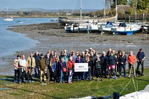 Libby Alexander from SOS-C, centre, with John Nelson, chairman of Chichester Harbour Trust, and concerned residents at Dell Quay