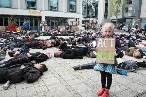 A die-in held at Jubilee Square, Brighton, by Extinction Rebellion activists (Credit: Danny Fitzpatrick)